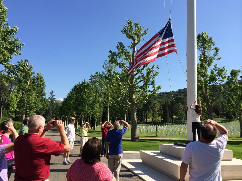 University of Oklahoma alumni lowered the flag at the American cemetery in Florence.