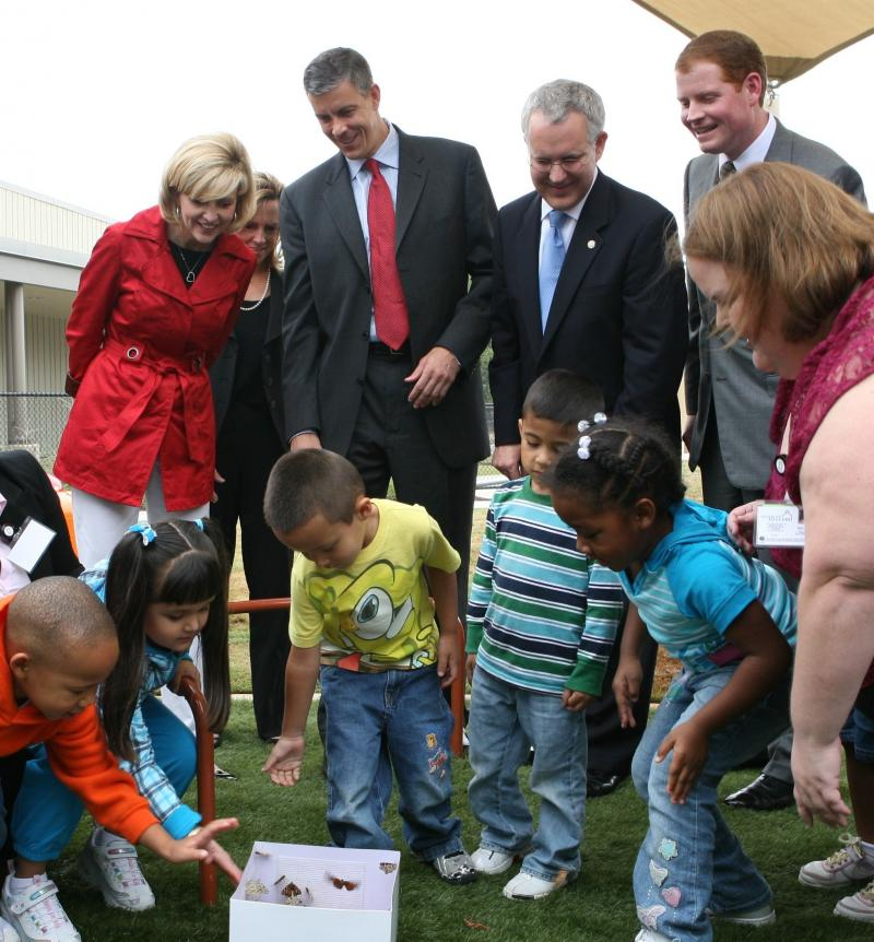 Oklahoma first lady Kim Henry, U.S. Secretary of Education Arne Duncan, Oklahoma Gov. Brad Henry and Inasmuch Foundation President and Chairman of Oklahoma City Educare Bob Ross with children and a teacher at the dedication of Oklahoma City Educare, 2009.