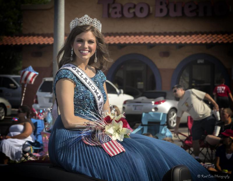 Miss Oklahoma Teen USA 2013 Graham Turner rides through her hometown atop a float at Edmond's 2013 LibertyFest Parade.