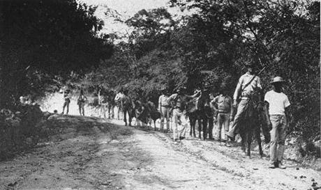 United States Marines on patrol in 1915 during the occupation of Haiti. A Haitian guide is leading the party.