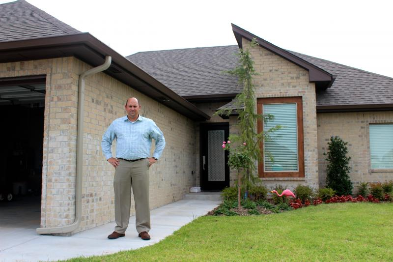 Scott Burkhart rebuilt his house using an SBA disaster loan after the May 20 tornado leveled his home in Moore, Okla.