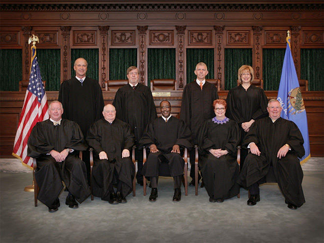 The Oklahoma Supreme Court in 2015: Standing (Left to Right): Vice-Chief Justice Douglas L. Combs Justice James E. Edmondson, Justice Steven W. Taylor, Justice Noma Gurich. Sitting (Left to Right): Justice Joseph M. Watt, Chief Justice John F. Reif, Just