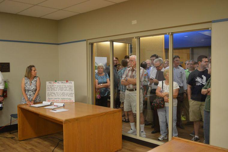 Many residents hoping to attend a Forum on Fracking were not allowed to enter the Lowry room at the Norman Public Library on Monday night, Aug. 11, 2014 because the crowd exceeded the legal capacity of the room.