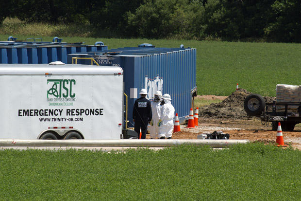 Workers clean up an acid spill in Kingfisher County.