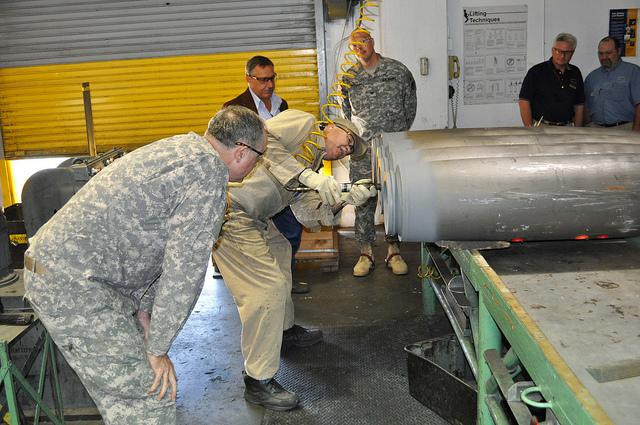 LTG Pillsbury watching removal of a bomb rear casing plate in 2010 at the McAlester Army Ammunition Plant.