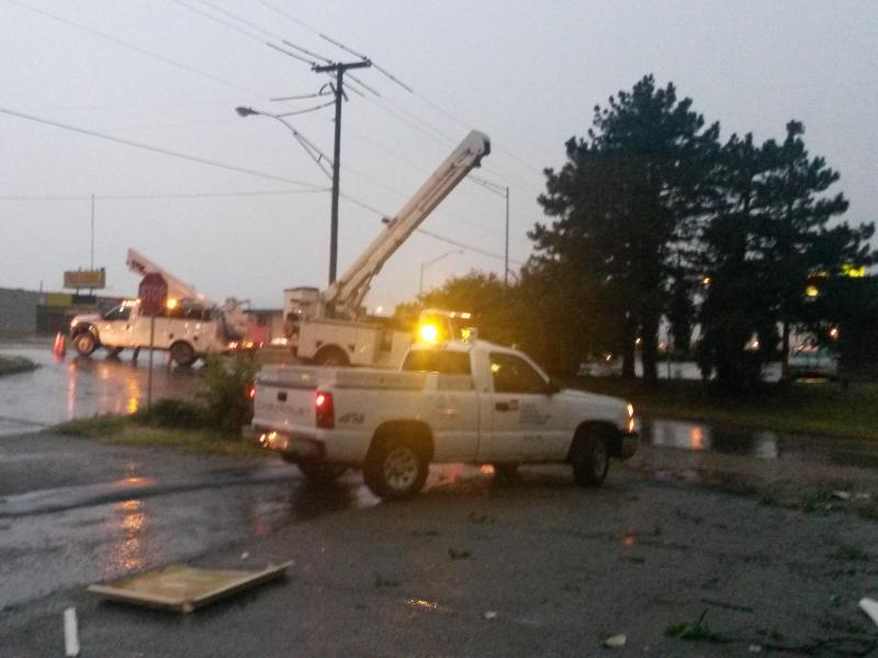 Crews work to repair damage caused by high winds in Bartlesville Monday evening.