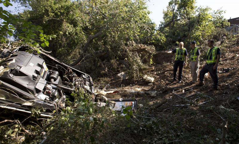 National Transportation Safety Board member Robert Sumwalt and investigator-in-charge Jennifer Morrison view wreckage at the scene in Davis.