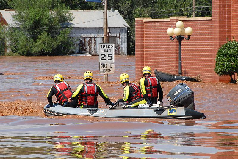 Kingfisher, OK, August 19, 2007 -- A Rescue Boat searches for stranded people in downtown Kingfisher. People were rescued when flood waters rose and stranded them.