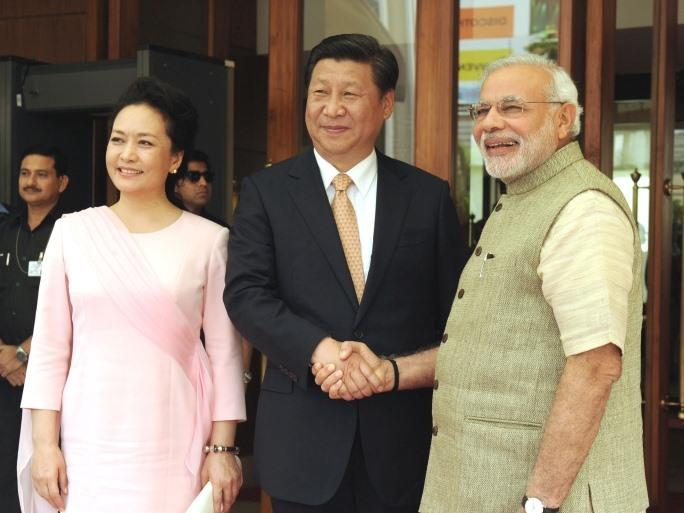 India's prime minister Narendra Modi greets Chinese President Xi Jinping, September 17, 2014