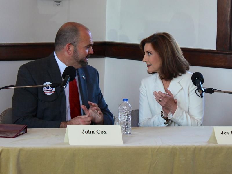Democratic superintendent canddiate John Cox and Republican nominee Joy Hofmeister exchange words during an Oct. 19, 2014 debate at the Norman Depot.