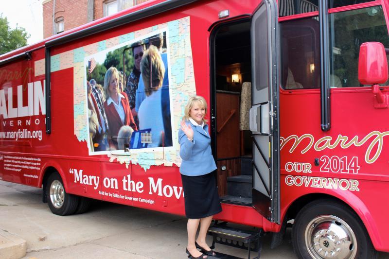 Gov. Mary Fallin boards her campaign RV in Watonga, Okla.