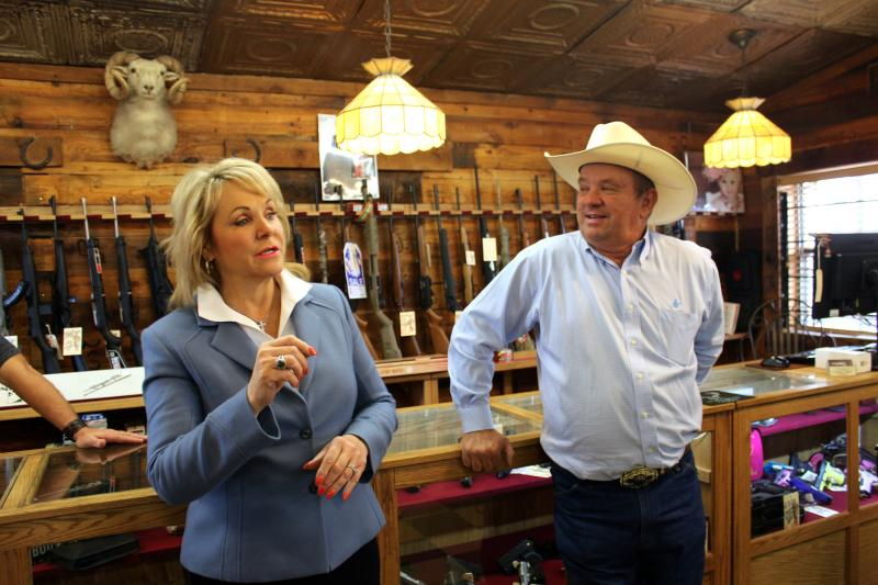 Gov. Mary Fallin talks to constituents at the Cordell Gun Store in New Cordell, Okla.