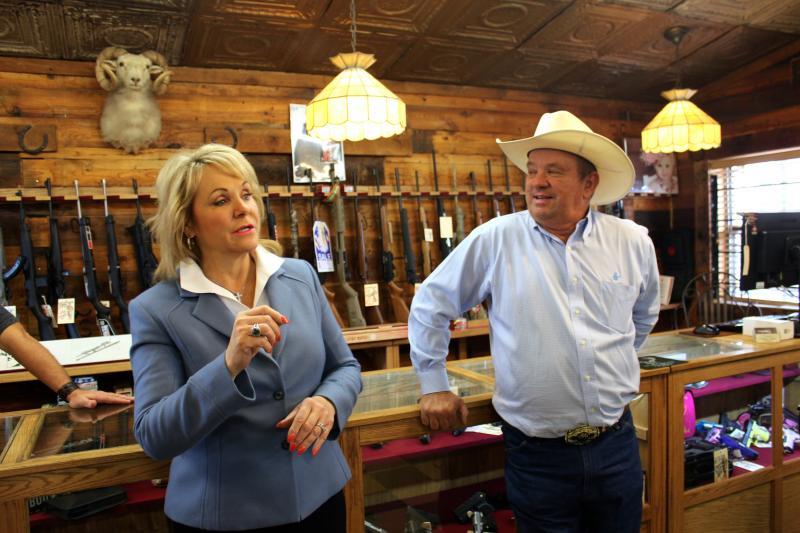 Gov. Mary Fallin talks to constituents at the Cordell Gun Store in New Cordell, Okla.