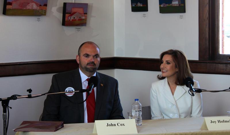 John Cox and Joy Hofmeister met to discuss public education Oct. 19 at Norman's Santa Fe Depot