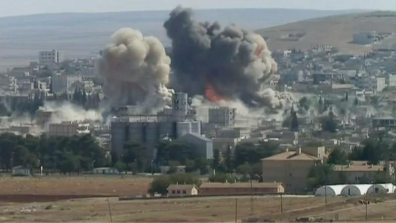 Islamic State members claim these twin explosions on October 8 in southeastern Kobani was not caused by airstrikes but was executed by the suicide bomber Abu Talha al-Ansari.