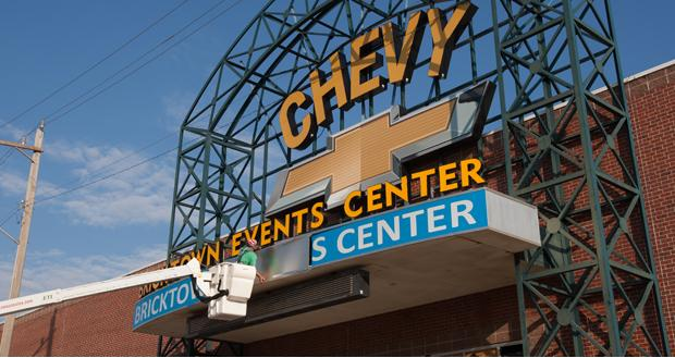A worker repairs a sign above the Chevy Bricktown Events Center in Oklahoma City.