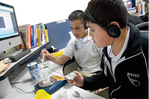ASTEC high school students work as a team to conduct a science experiment at a Module workstation. The Advanced Science and Technology Education Charter (ASTEC) Schools became Oklahoma's first start-up charter school in 2000.