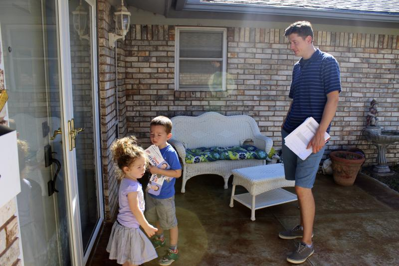 State Sen. David Holt (R-Oklahoma City) knocks doors for State Representative Jason Nelson (R-Oklahoma City) with his children Maggie and George.