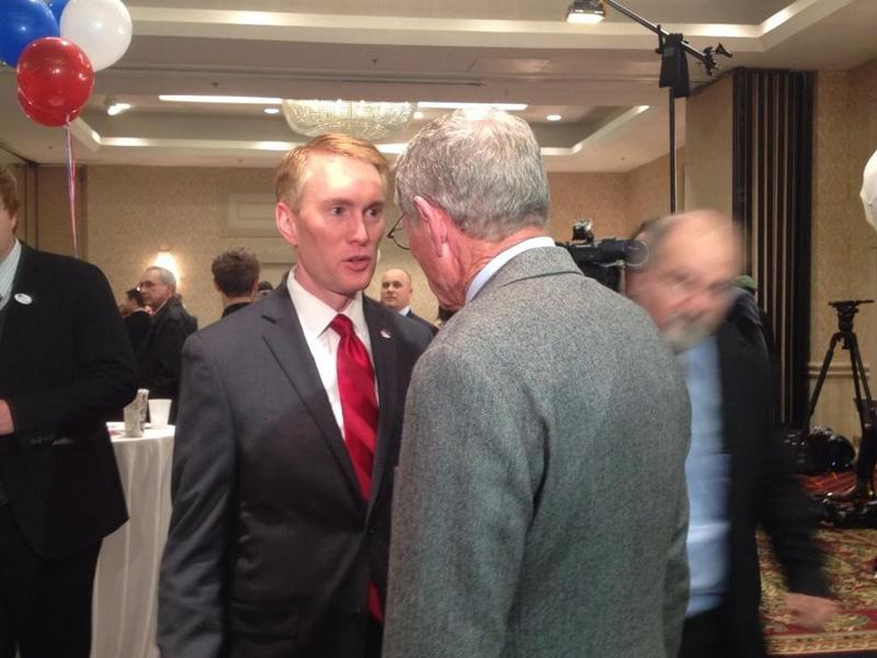 U.S. Senator-elect James Lankford talks with his new colleague Jim Inhofe at a watch party during the Nov. 4, 2014 midterm election.