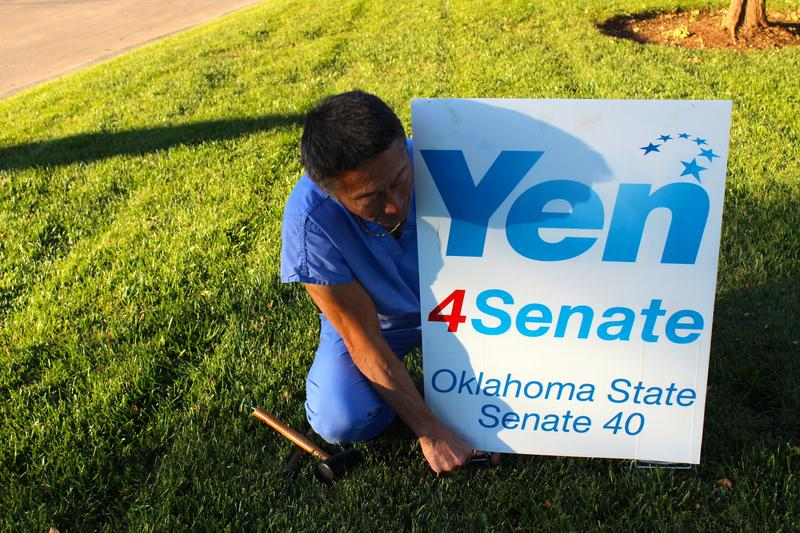 Dr. Ervin Yen gathers campaign signs after winning the open seat for Senate District 40