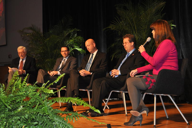 Left-to-right: Economists Robert Dauffenbach, Russell Evans, Mickey Hepner, and Dan Rickman during a panel discussion moderated by Oklahoma City advertising executive Rhonda Hooper