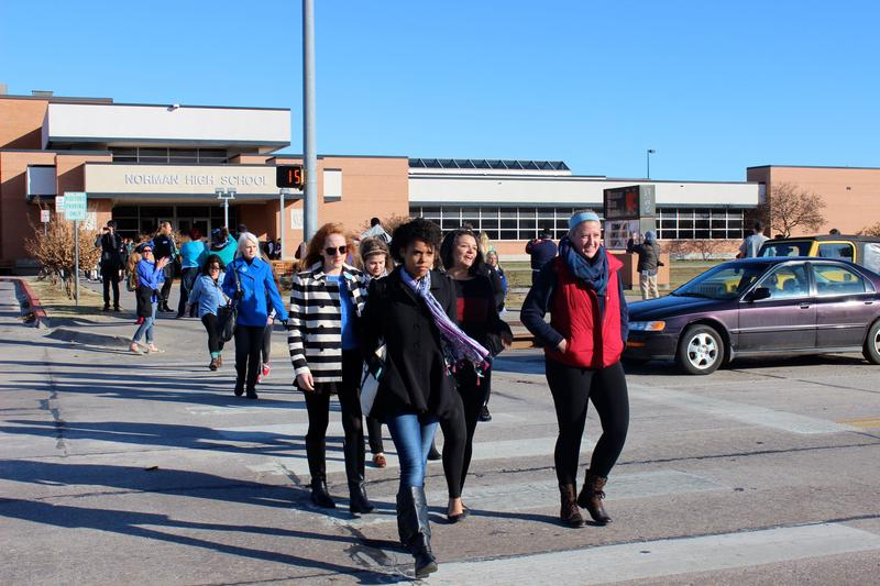 Students at Norman High School walk out of class at 9:20 a.m. Monday in support of alleged sexual assault victims who were bullied out of school.