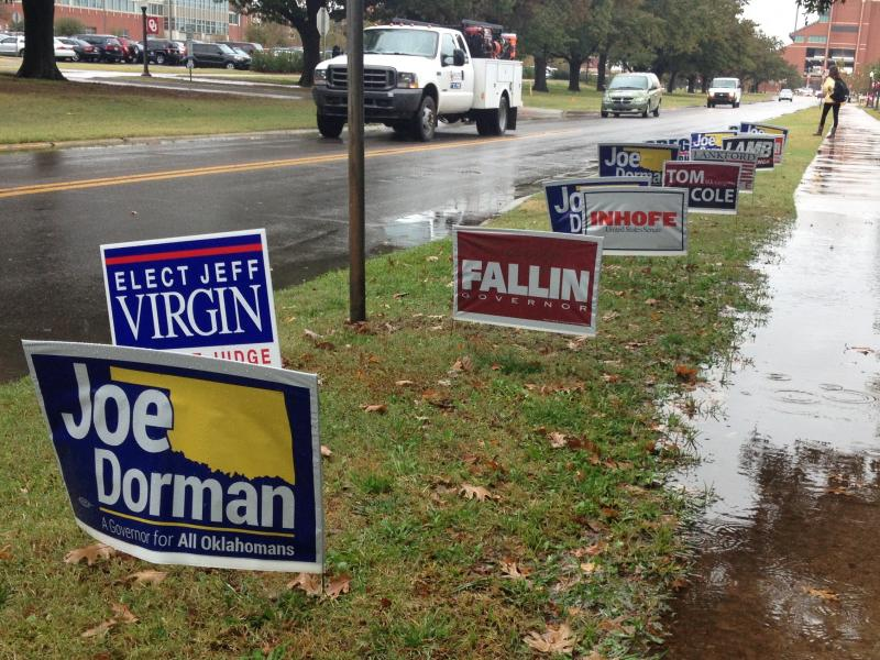 2014 midterm election campaign signs along Jenkins Ave. in Norman just southeast of the University of Oklahoma campus.