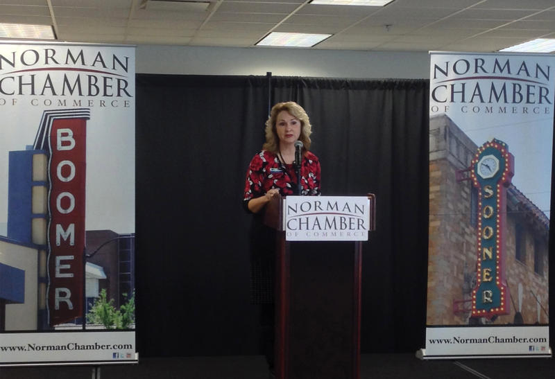 Moore Norman Technology Center Superintendent Jane Bowen speaks during the 2014 Norman State of Schools luncheon.