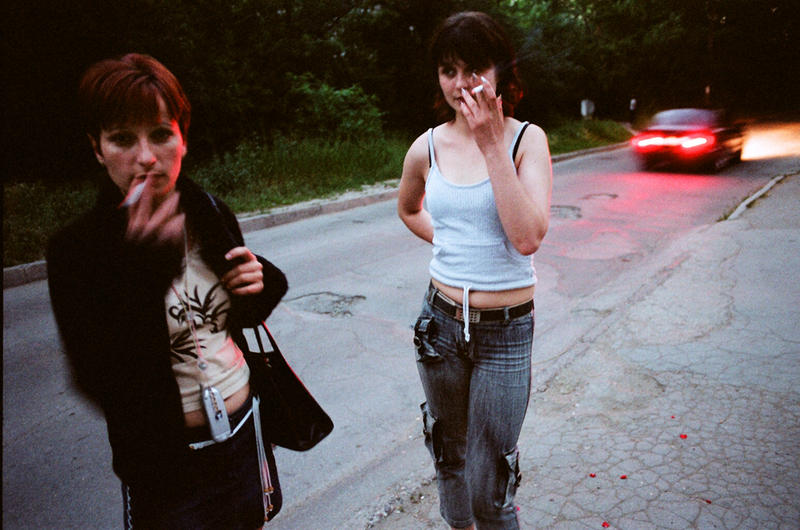 Two Moldovan women await their ride in front of the shelter for trafficked girls in 2004.
