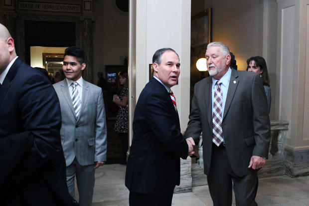 Oklahoma Attorney General Scott Pruitt shakes hands at the state Capitol after the annual State of the State address.