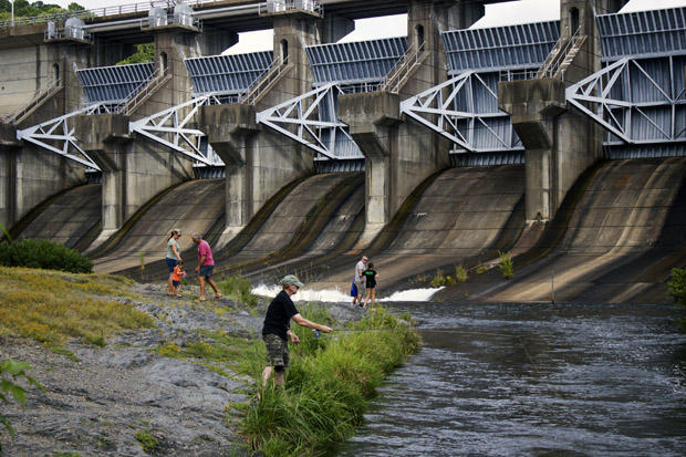 Families and a fisherman along the spillway beneath Broken Bow Dam in southeastern Oklahoma.