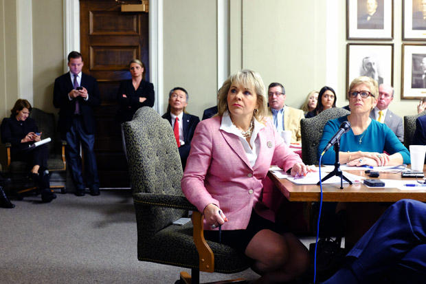 Gov. Mary Fallin and other state leaders observe a PowerPoint presentation of revenue projections.