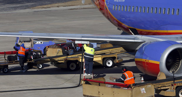 Crew members service a Southwest Airlines jet at Tulsa International Airport.