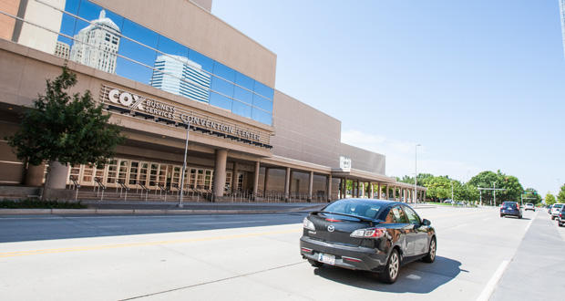 Traffic passes in front of the Cox Convention Center in downtown Oklahoma City.