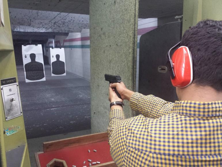 A patron at H&H Shooting Sports in Oklahoma City practices at the complex's gun range. The business also teaches handgun training classes, but a loophole in state law allows some to circumvent the state's in-person firearms training requirements.