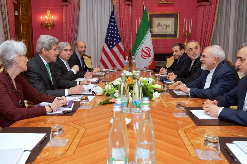 U.S. Secretary of State John Kerry, flanked deputies, sits across from Iranian Foreign Minister Javad Zarif and other advisers on March 17, 2015, in Lausanne, Switzerland, before resuming negotiations about the future of Iran's nuclear program.