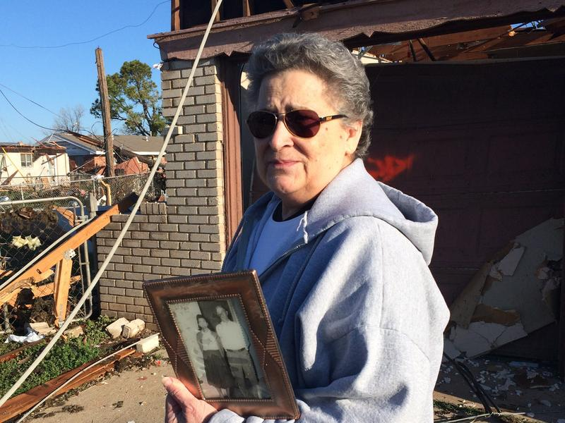 "Moore resident Joetta Strain holds her ""prized possession,"" a photograph of her parents she's had since she was 16. The home she's lived in since 1973 is likely a total loss after Wednesday's tornado."