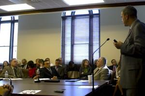 Austin Holland with the Oklahoma Geological Survey, seated in the center, at a capitol hearing on Oklahoma's earthquake surge.