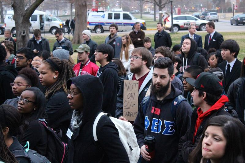 Demonstrators gather outside Evans Hall on the University of Oklahoma campus Monday morning to protest the video with racist chants allegedly by Sigma Alpha Epsilon fraternity members.