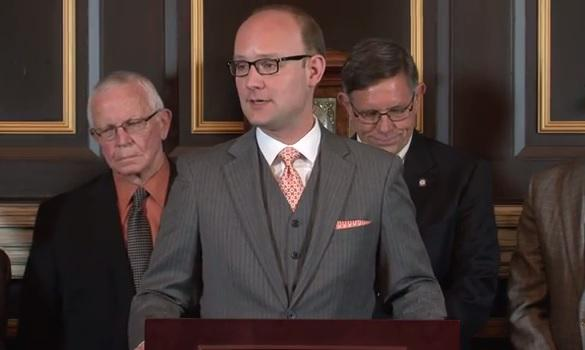 Oklahoma House Democratic Leader Scott Inman (D-Del City), flanked by state Reps. Ed Cannaday and Donnie Condit, during Monday's press conference marking 25 years since the passage of HB 1017.