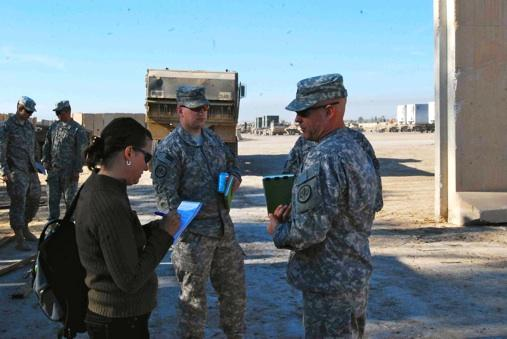 Jackie Spinner interviews a soldier in Iraq during her time as a Washington Post correspondent.
