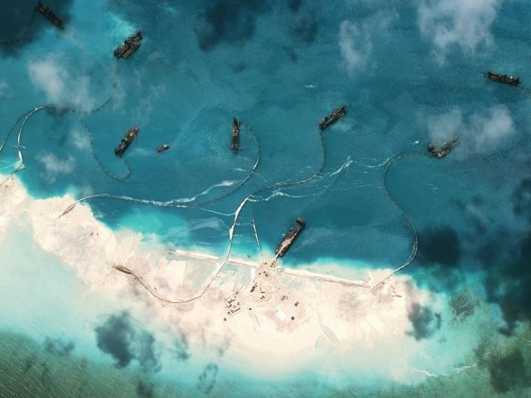 Satellite images from March 17, 2015 show new structures and construction equipment present on Mischief Reef in the South China Sea