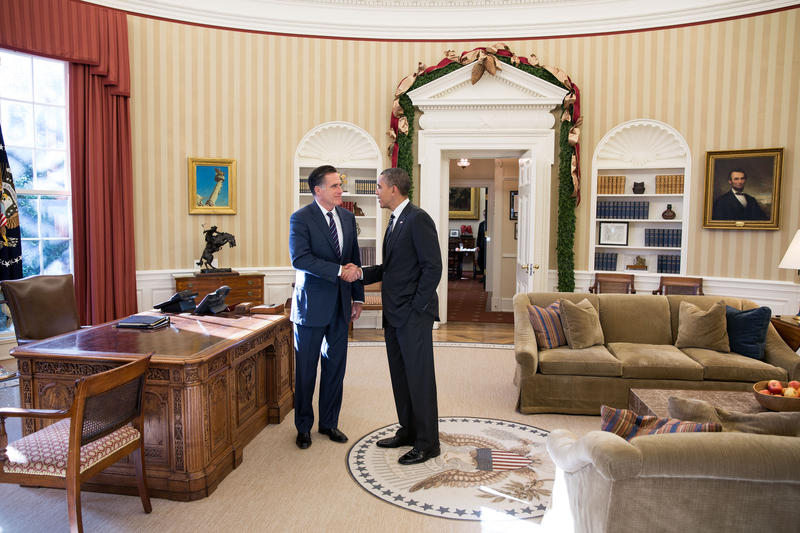 President Obama and former Massachusetts Gov. Mitt Romney talk in the Oval Office following their Nov. 29, 2012 lunch.