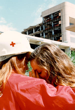 An American Red Cross volunteer hugs a victim after the Oklahoma City bombing in April 1995.
