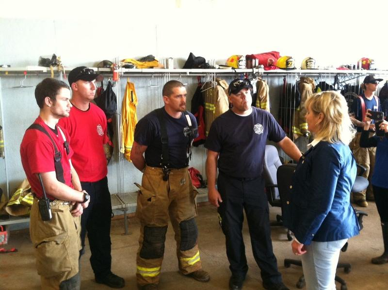 Gov. Mary Fallin meets with firefighters in Bridge Creek Thursday morning, a day after a tornado destroyed several buildings in the central Oklahoma community.