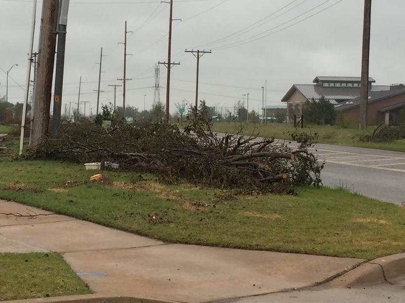 Storm debris piled along 36th Ave. NW just north of Tecumseh Road in Norman