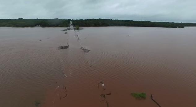 Aerial footage of floodwaters covering Alameda Street as it crosses Lake Thunderbird in far east Norman on May 24, 2015.