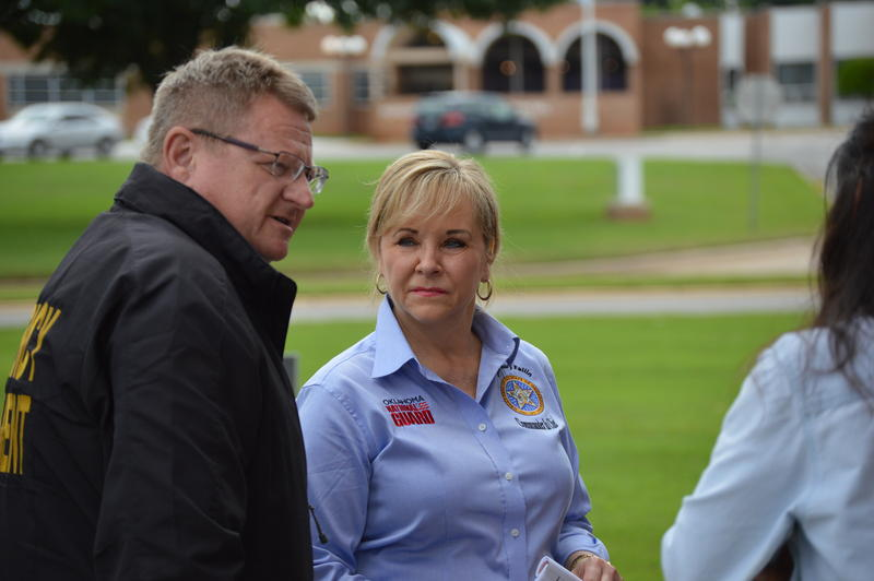 Oklahoma Governor Mary Fallin and Oklahoma Emergency Management director Albert Ashwood meet with first responders in Purcell on May 27, 2015.