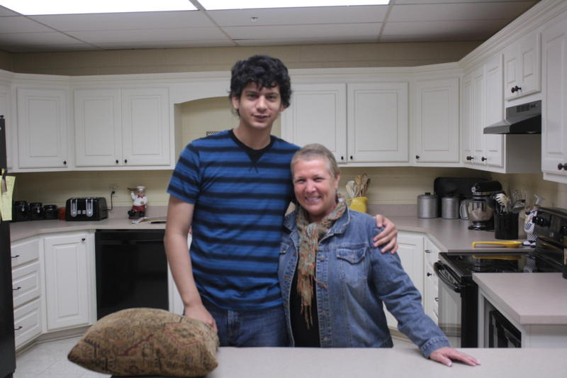 Robyn Venable poses with one of her students in her teaching kitchen at Charles Page High School in Sand Springs, Oklahoma. Venable is retiring this year.