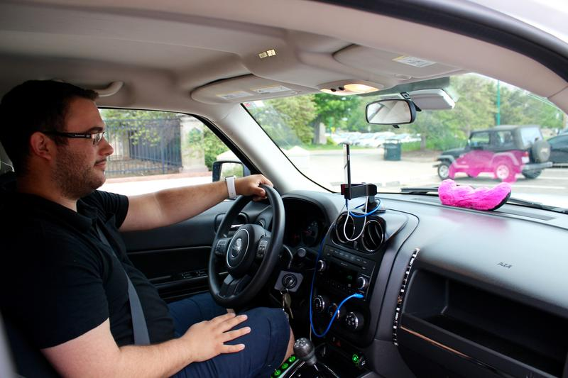 Marcus Prince drives his Jeep Liberty for the rideshare company Lyft